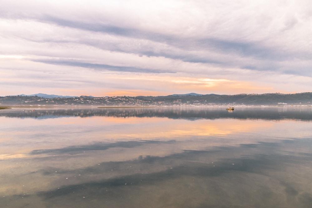 knysna lagoon at sunset in pastel colours by katja photography
