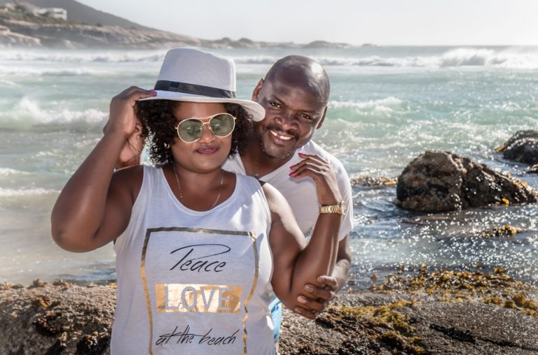lifestyle portrait of an African couple posing at the beach by katja photography