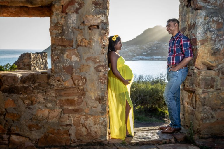 lifestyle portrait of pregnant couple posing at old ruins by katja photography