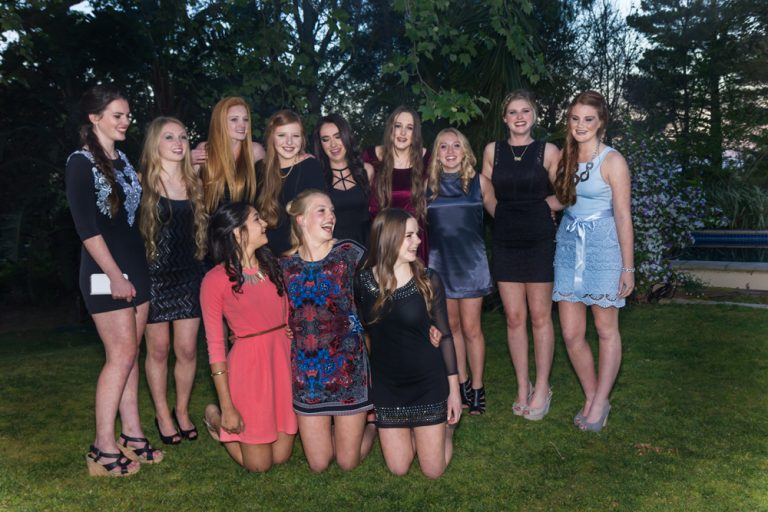 large group of teen girls dressed in evening wear posing and laughing by katja photography events