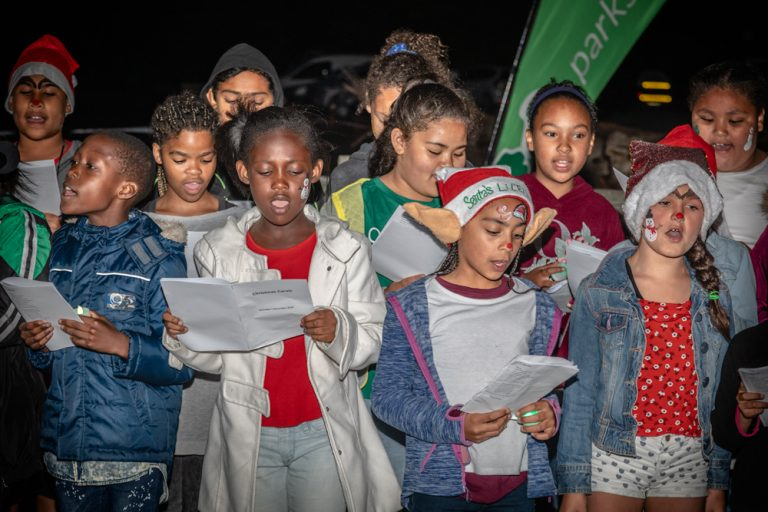 group of young multi racial children singing in a choir by katja photography events