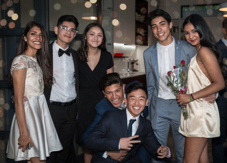 group of teens posing in evening wear smiling by katja photography events