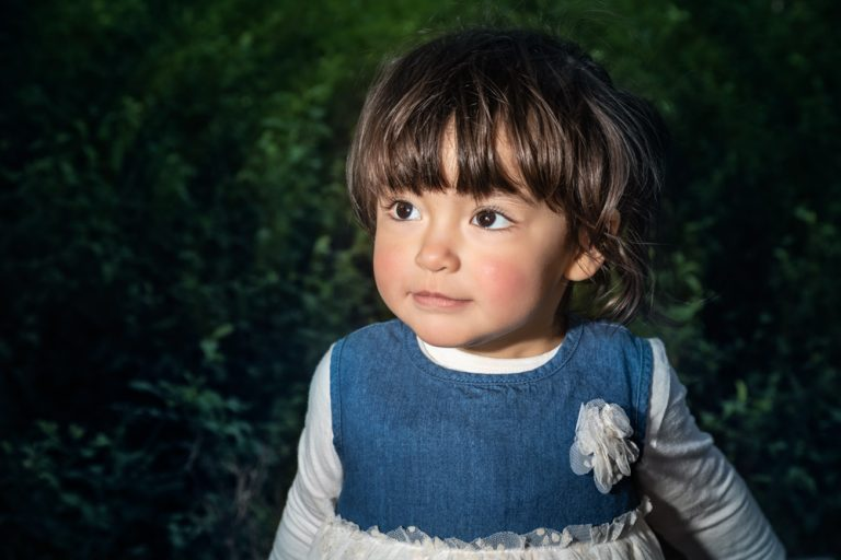 lifestyle portrait of toddler girl with black hair by katja photography