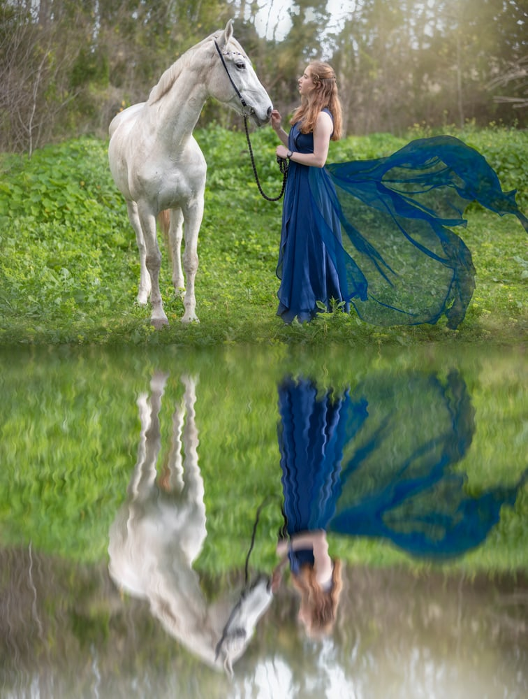 fine art portrait of a woman and horse reflecting in water by katja photography