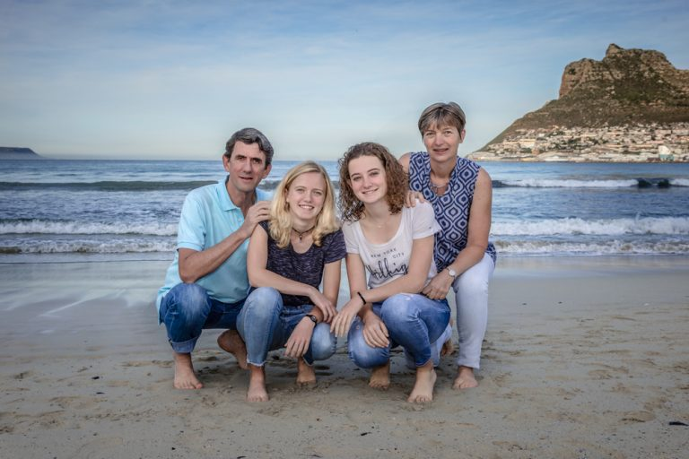 lifestyle portrait of family posing on the beach by katja photography