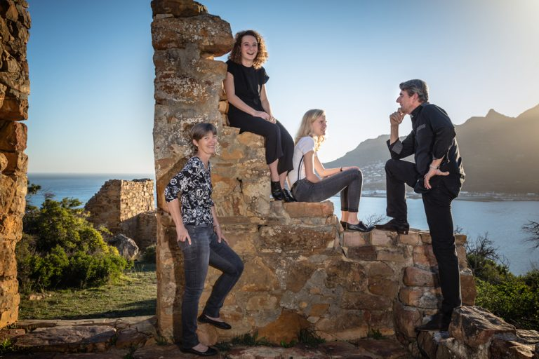 lifestyle portrait of family posing at old ruins by katja photography