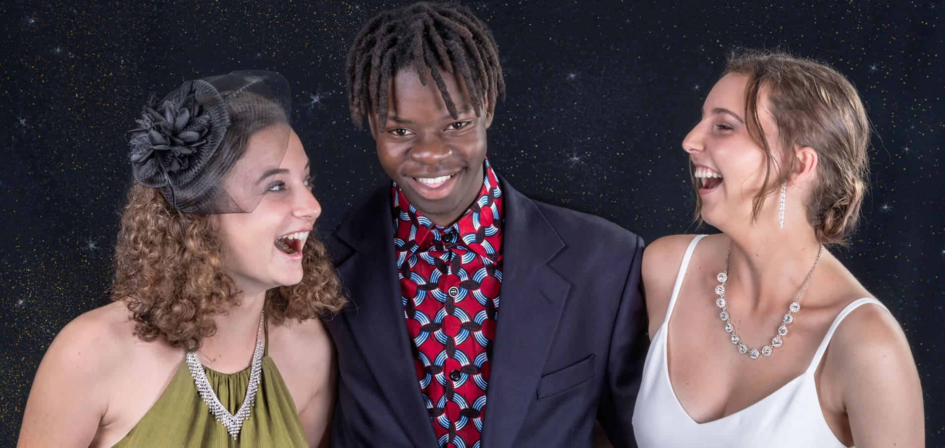 studio portrait of three laughing multi racial friends dressed in evening wear by katja photography