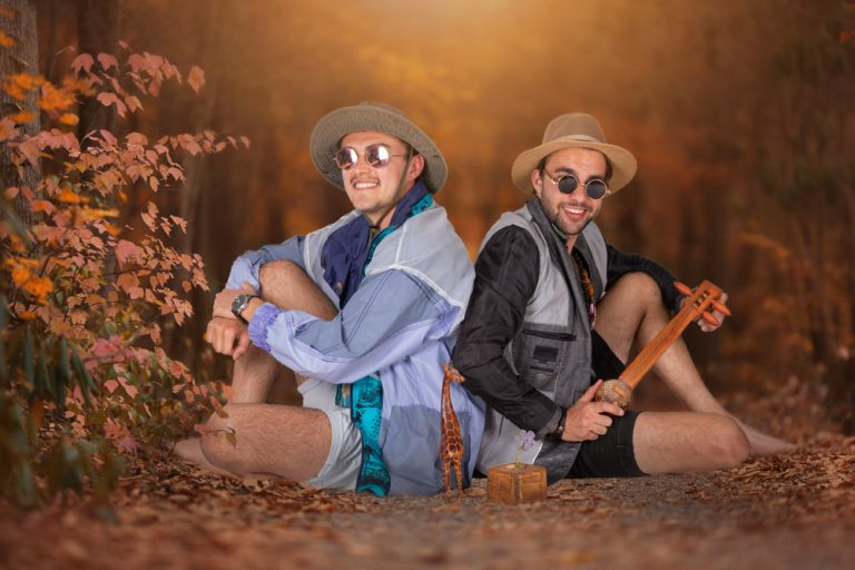 fine art portrait of two young men sitting in autumn forest dressed casually by katja photography