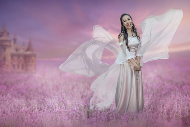 fine art portrait of a young woman in formal dress with flowing material in a lavender field by katja photography