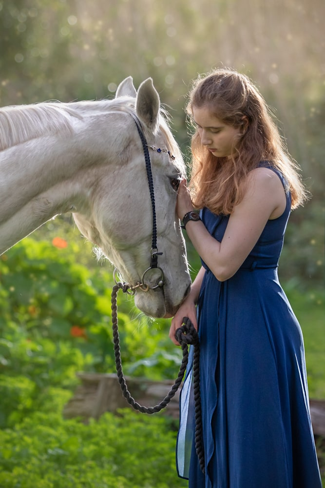 lifestyle portrait of a woman and white horse bonding by katja photography