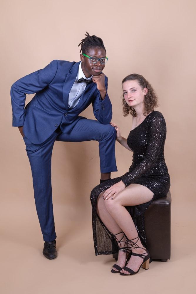 studio portrait of multi racial couple posing in formal wear by katja photography