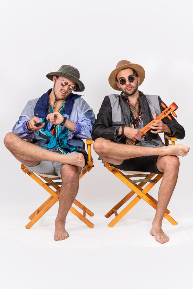 studio portrait of two young men sitting in chairs dressed in casual clothing by katja photography